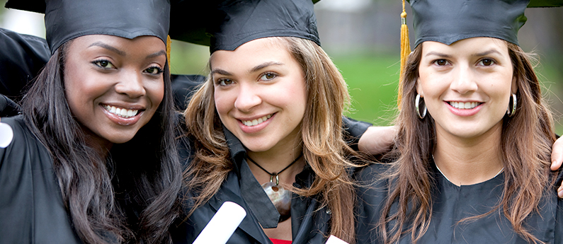 Three young woman in graduation caps and gowns